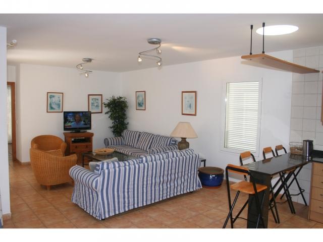 Lounge with doors to Pool! - 3 bed villa Los Coloradas, Playa Blanca, Lanzarote